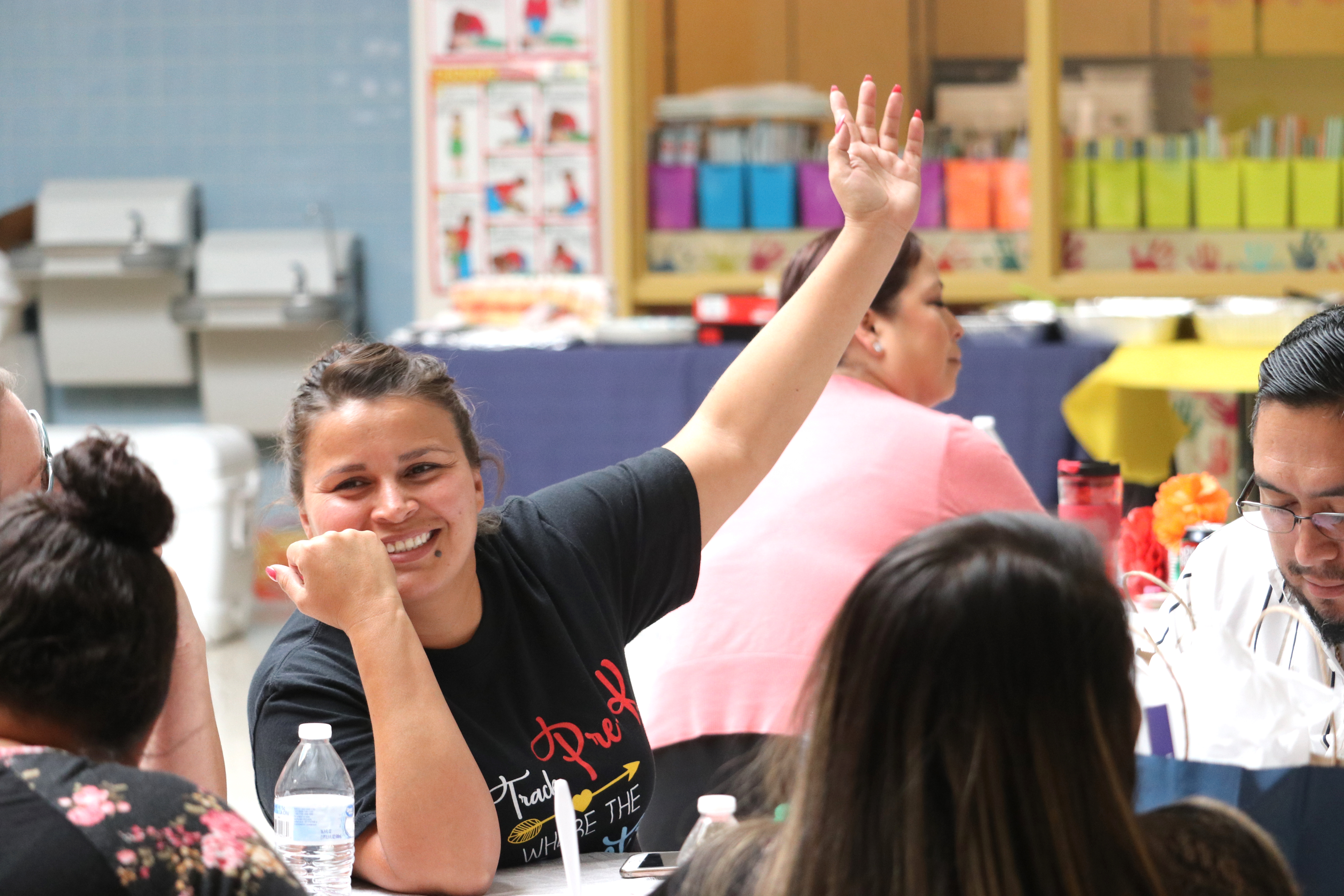 Nonprofit Conference Attendee raising hand