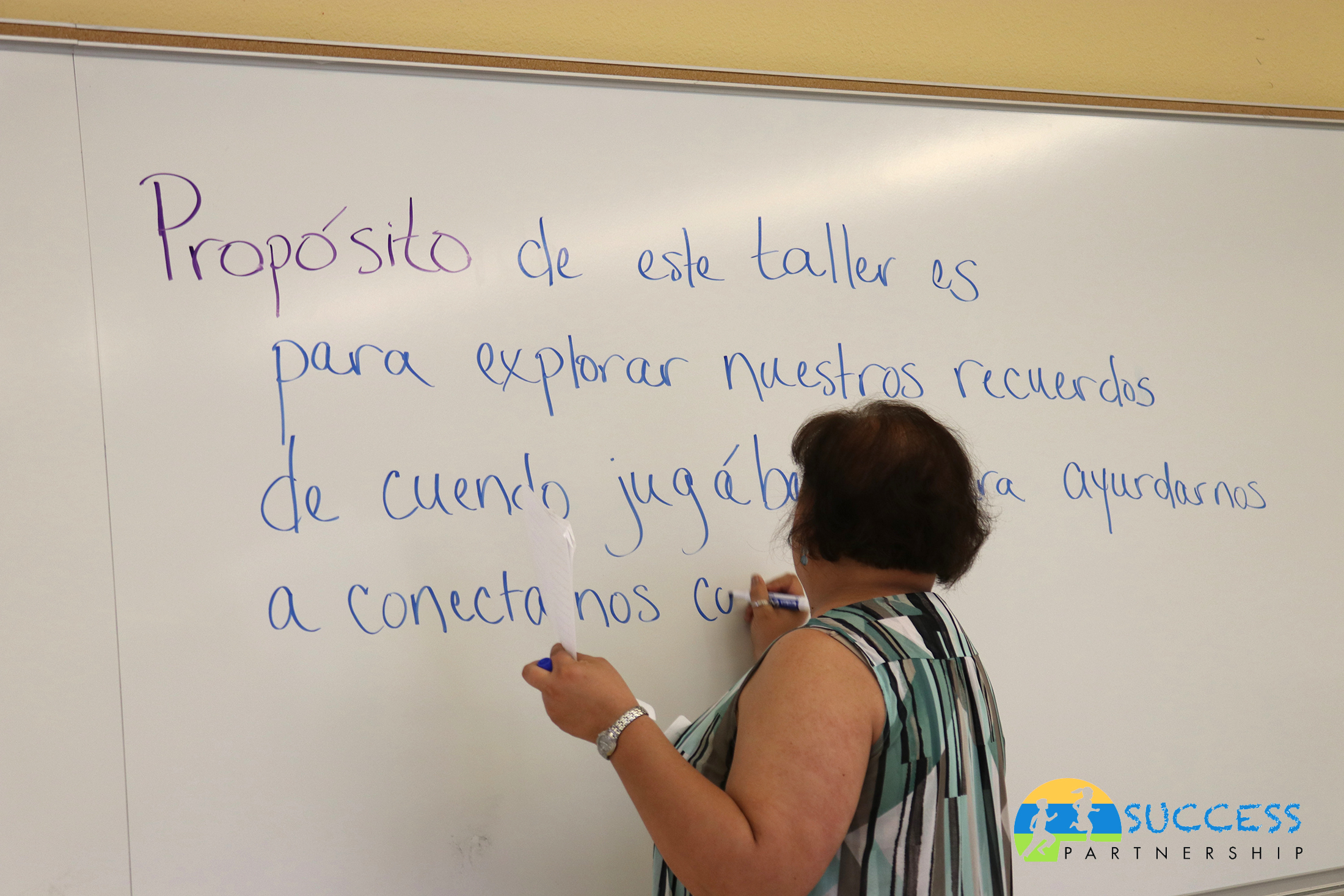 Teacher writing on the white board